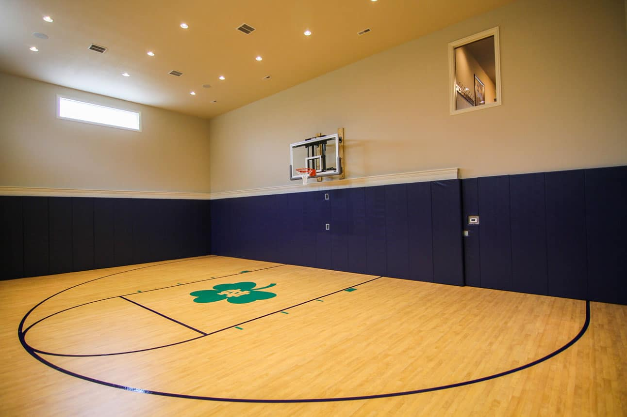 Elegant custom home indoor basketball court notre dame for Custom indoor basketball court
